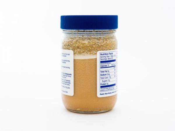 1 lb. Glass Jar of Really Raw Honey with an extra amount of our cappings on top.