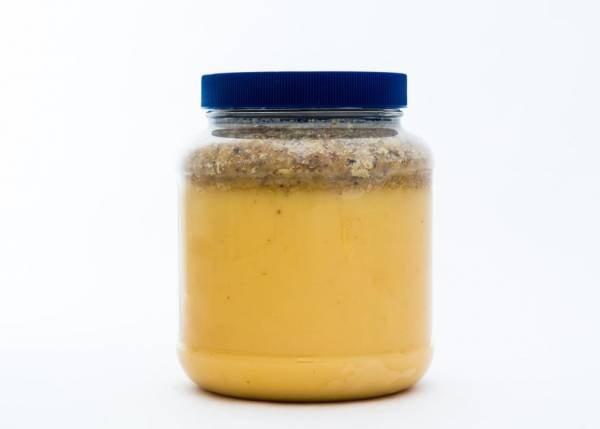 5 lb. Plastic Jar of Really Raw Honey with an extra amount of our cappings on top